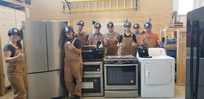 PAT Appliance Technician students working on Whirlpool appliances
