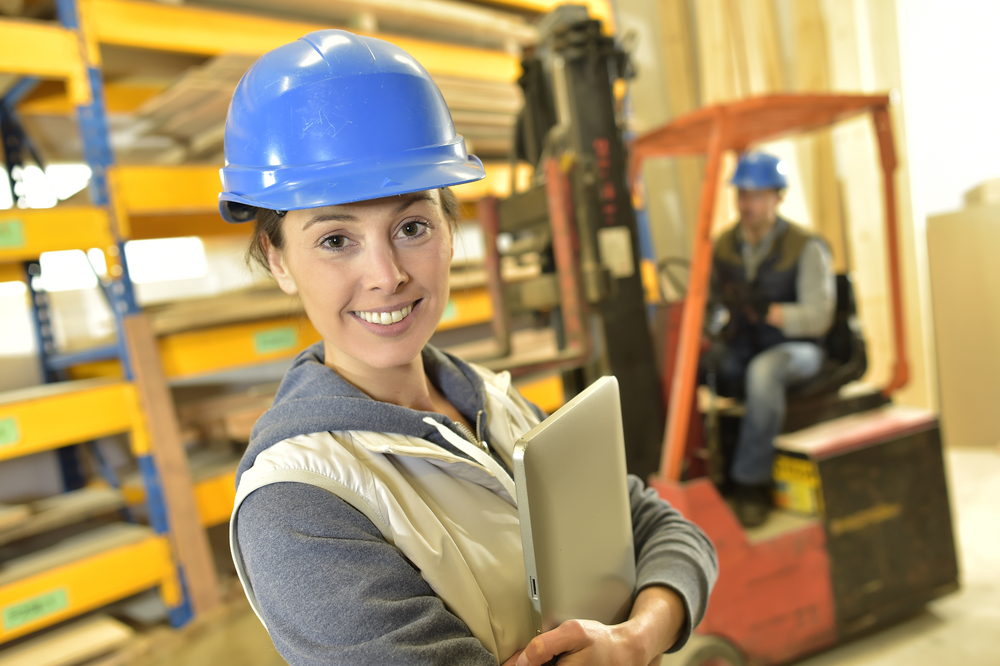 Smiling woman working in warehouse