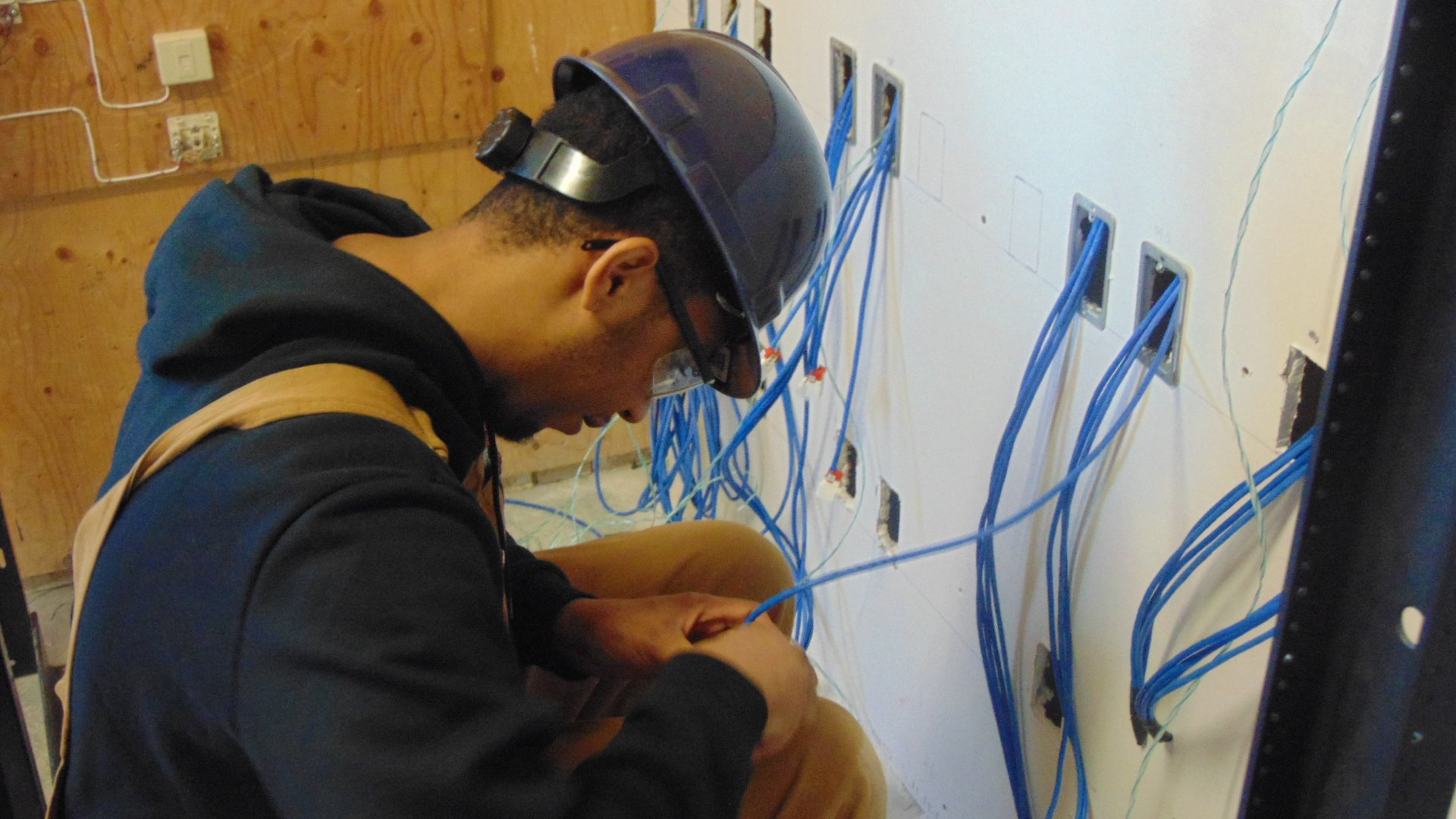 network cabling student in the workshop at Herzing College