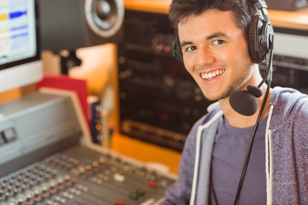 Portrait of an university student mixing audio in a studio of a radio.jpeg