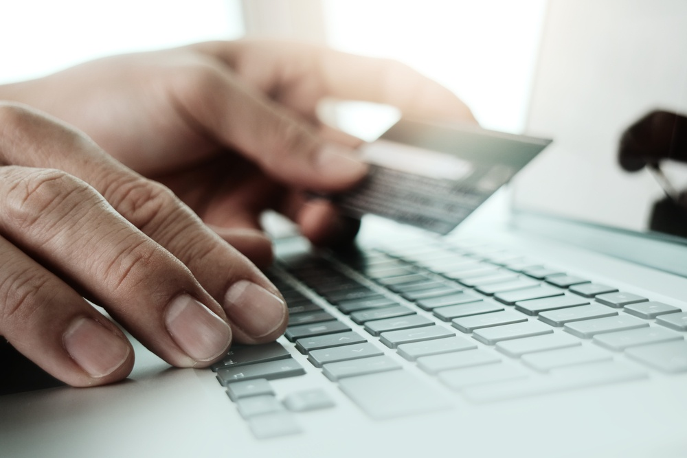 close up of hands using laptop and holding credit card  as Online shopping concept                    .jpeg